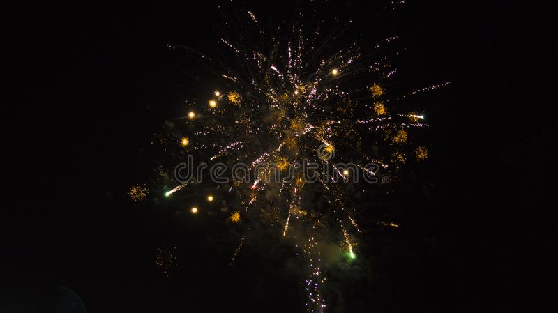Cheerful sparks in the night sky. Fireworks on holiday feared royalty free stock photos