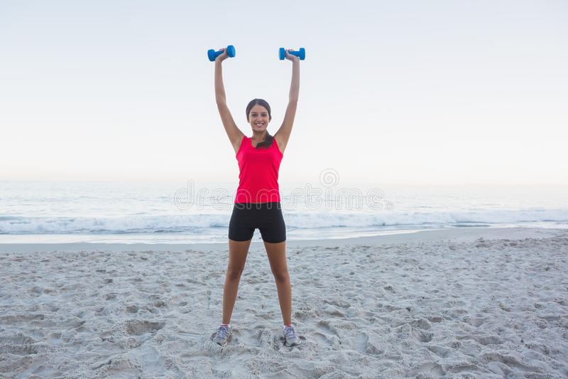 Cheerful Sporty Woman Holding Dumbbells Royalty Free Stock Photography