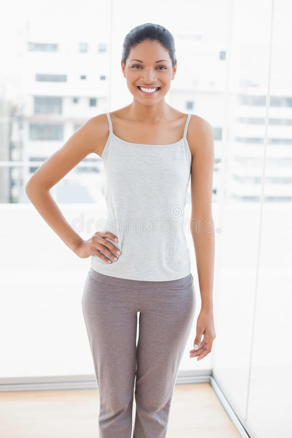 Cheerful sporty young woman posing stock photography
