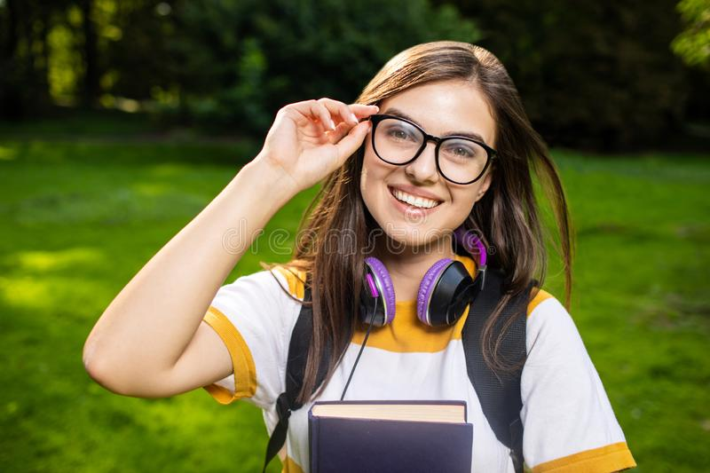 Cheerful Student Girl Adjusting Glasses royalty free stock images