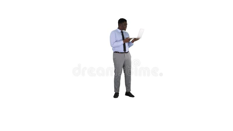 Cheerful successful young African American manager with laptop having video conference call with business partners on. Full length. Cheerful successful young stock photos