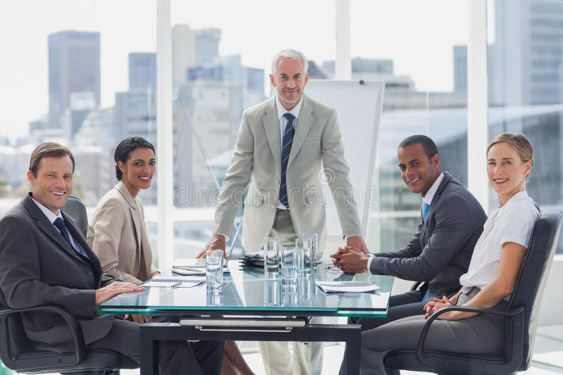 Cheerful team of business people in the meeting room royalty free stock photo