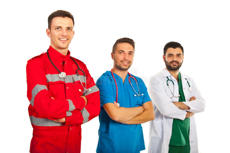 Cheerful team of different doctors. With arms folded isolated on white background royalty free stock image