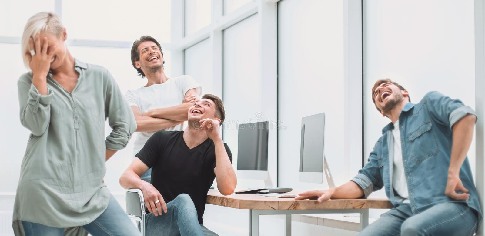Cheerful team of young people in the workplace. royalty free stock images