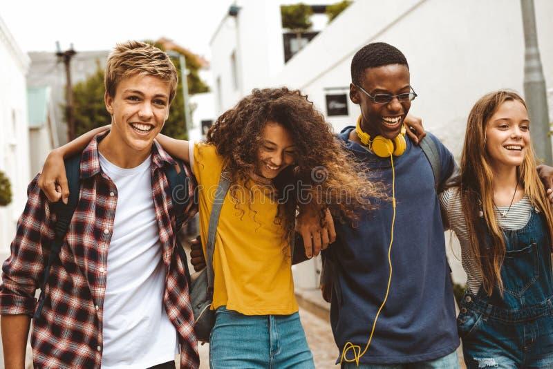 Cheerful teenage friends enjoying outdoors stock photo