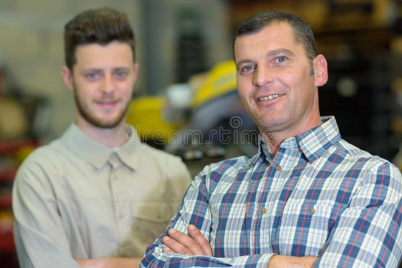 Cheerful teenager son with father portrait stock photos