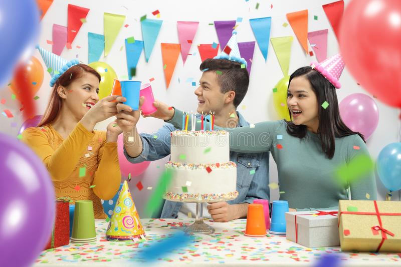 Cheerful teenagers celebrating a birthday stock image