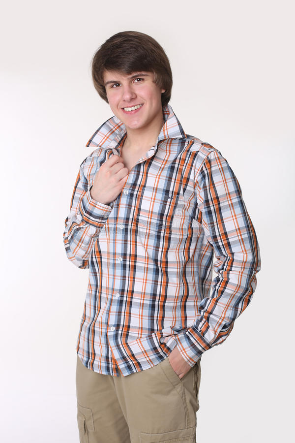 Cheerful toothy young man in checked shirt and smart casual wear royalty free stock images