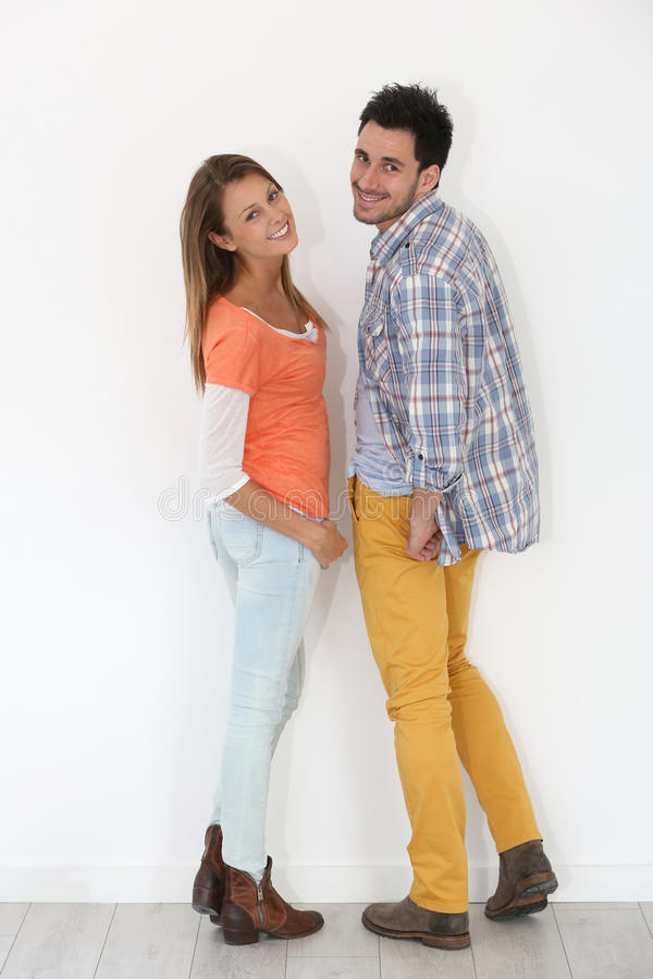 Cheerful trendy couple isolated. Cheerful trendy couple on white background stock image