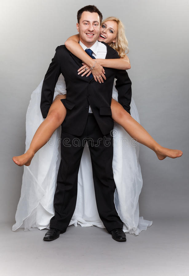 Cheerful wedding couple having fun bride groom embracing stock photos