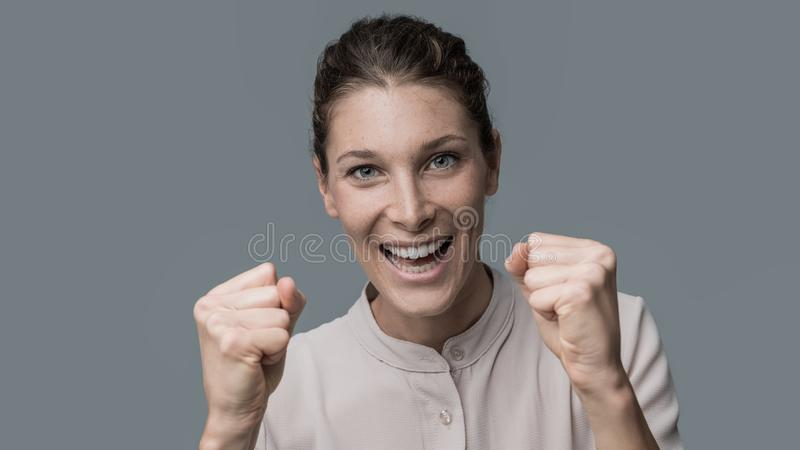 Cheerful winner woman stock photography