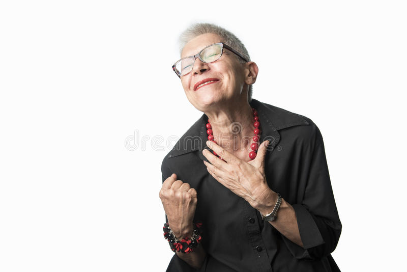 Cheerful winning senior woman. Happy and joyful older woman thrilled for her success stock images