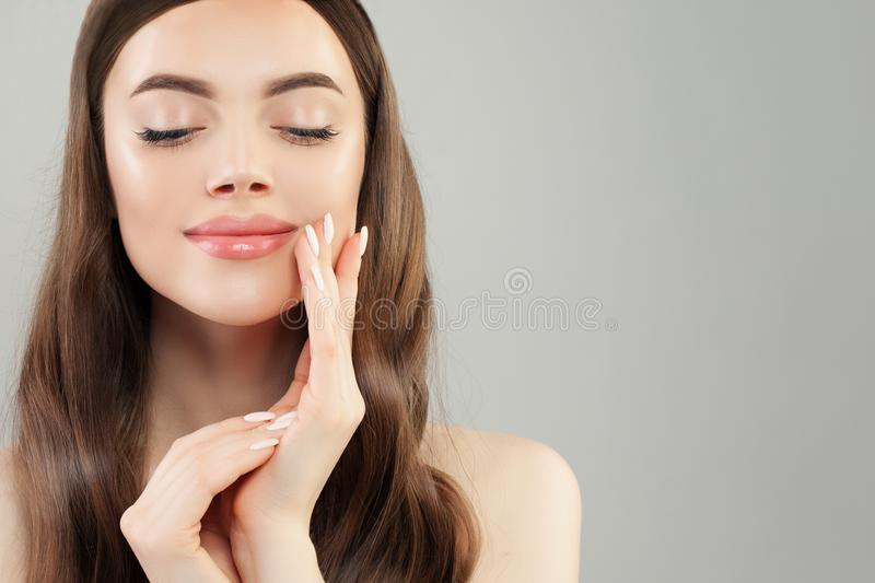 Cheerful woman with clear skin and manicured nails closeup portrait stock photography
