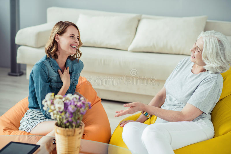 Cheerful woman and her senior mother talking royalty free stock photography