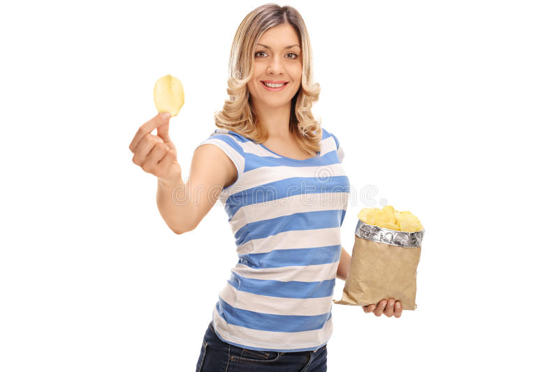 Cheerful woman holding a bag of chips stock photography