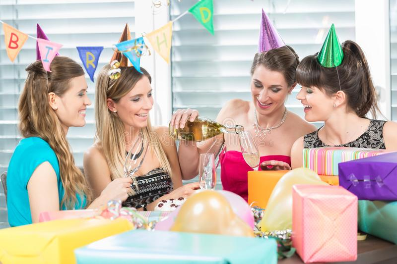 Cheerful woman holding a gift box during a surprise birthday party royalty free stock photo