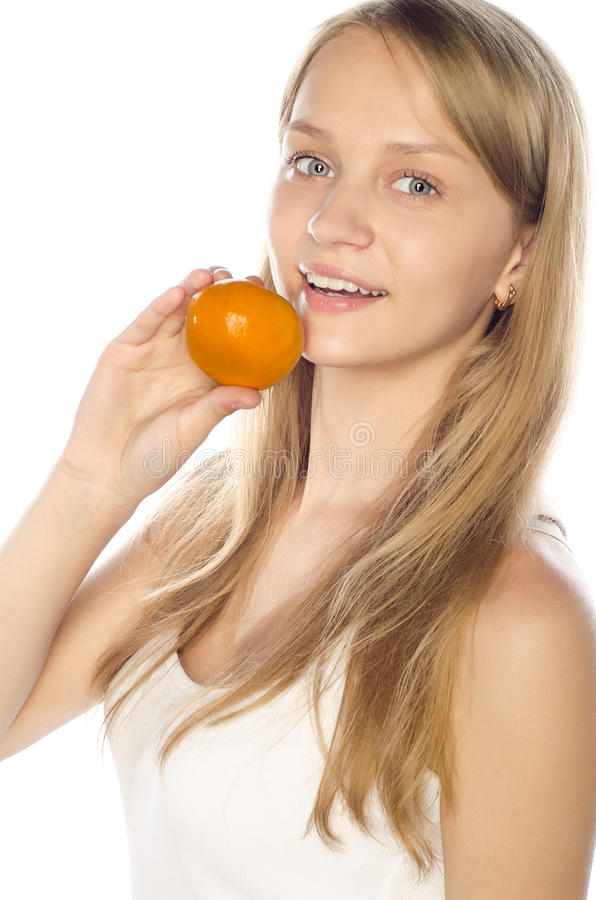 Download Cheerful Woman Holding A Tangerine Stock Image - Image: 25207299