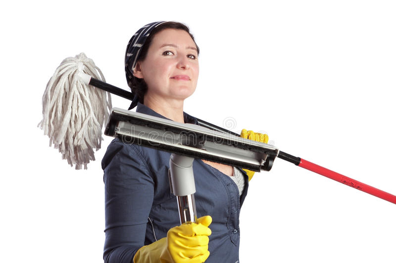 Cheerful woman housewife with vacuum cleaner and cleaning equipment. royalty free stock images