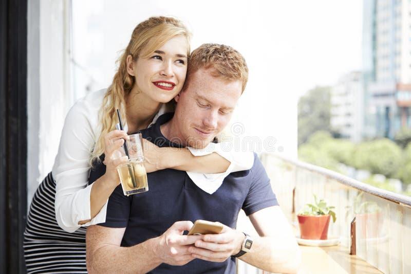 Cheerful woman hugging boyfriend royalty free stock photos