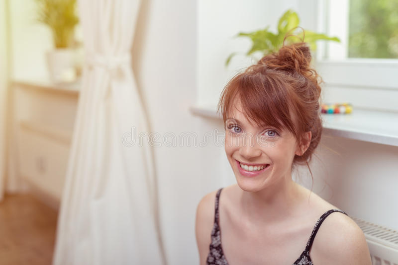 Cheerful Woman Inside the House Looking at Camera royalty free stock images