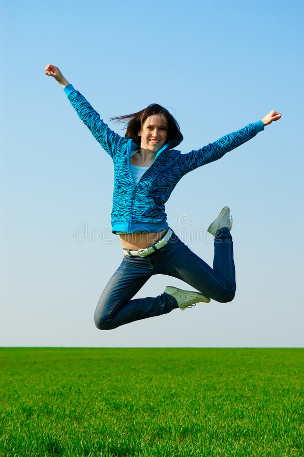 Cheerful woman jumping stock images