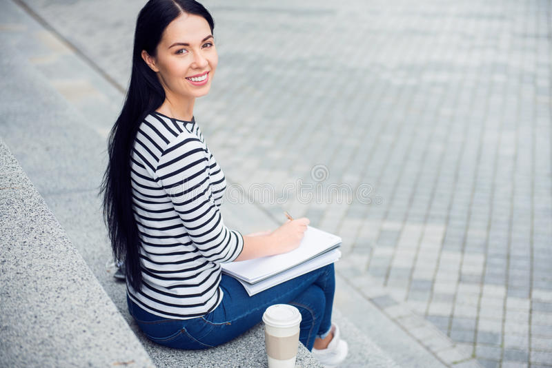 Cheerful woman making notes royalty free stock photos