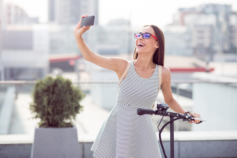 Cheerful woman making selfies royalty free stock images
