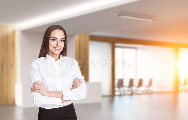 Cheerful woman in office with meeting room stock images