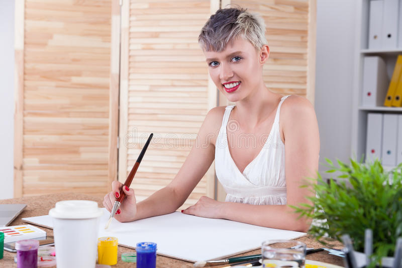 Cheerful woman painter royalty free stock photos