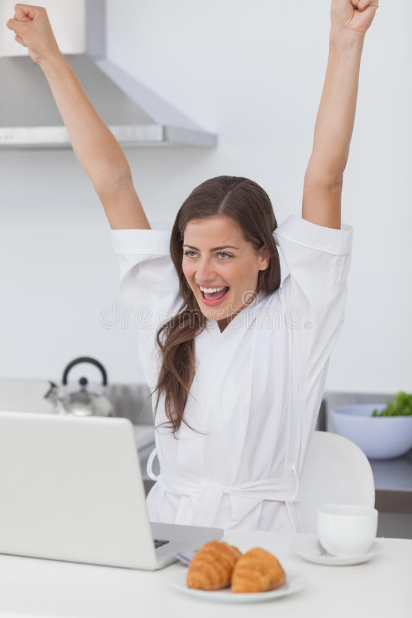 Download Cheerful Woman Raising Arms While Using A Laptop Stock Photo - Image: 32233042