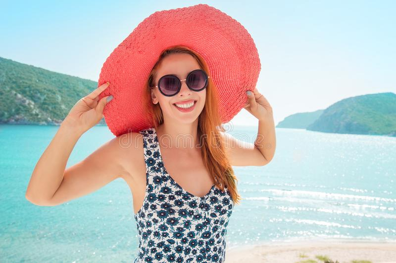 Cheerful woman relaxing on tropical background royalty free stock photography