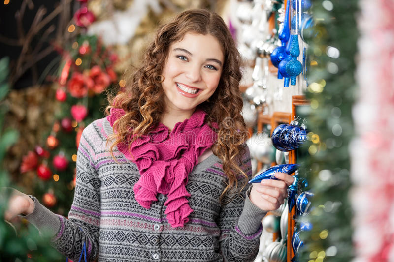 Cheerful Woman Shopping For Christmas Ornaments royalty free stock photos
