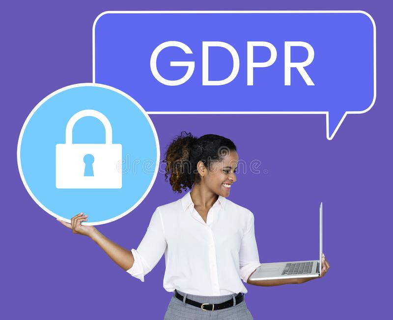 Cheerful woman showing a GDPR security padlock icon stock image