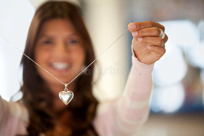 Cheerful woman with silver necklace