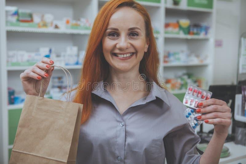 Beautiful woman shopping at the pharmacy stock photos