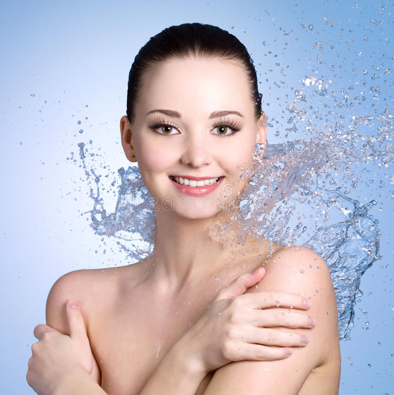 Download Cheerful Woman With Splashes Of Water Stock Photo - Image: 23682422