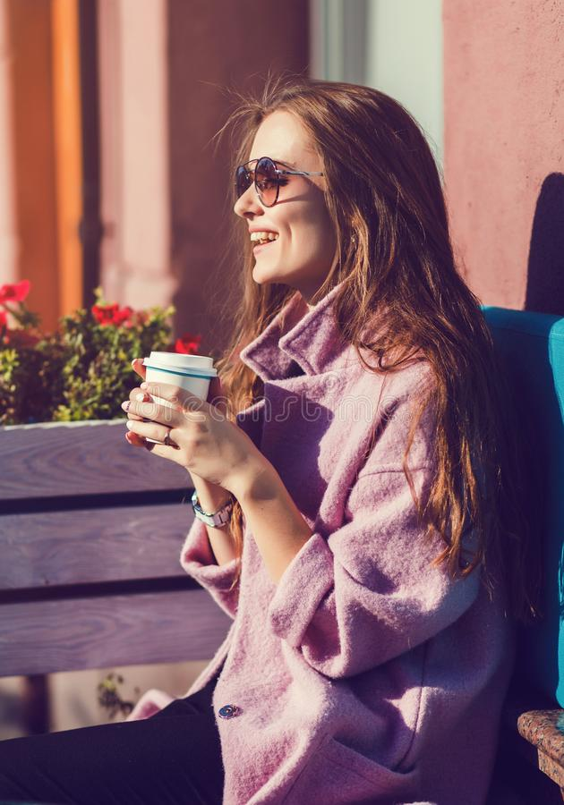Cheerful woman drinking coffee royalty free stock image