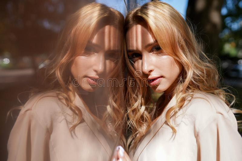 Cheerful woman in the street in sunshine light, Attractive blonde girl at summer day royalty free stock images