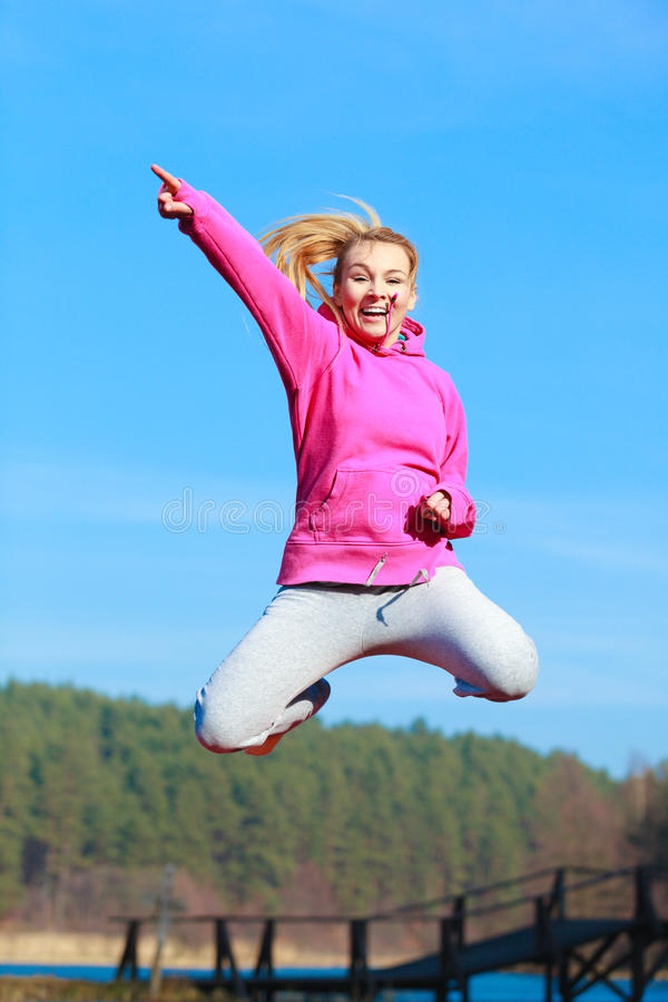 Download Cheerful Woman Teenage Girl In Tracksuit Jumping Showing Outdoor Stock Photo - Image of sportwear, cheerful: 39507096