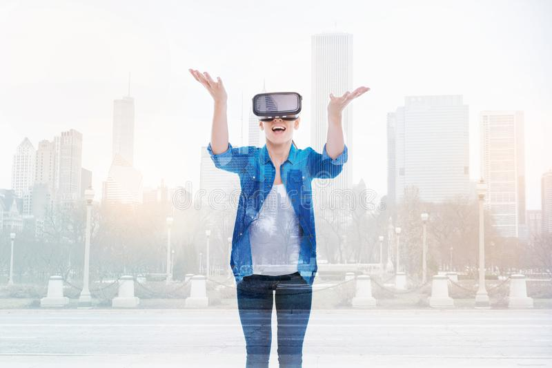 Cheerful woman throwing something in VR game royalty free stock photo