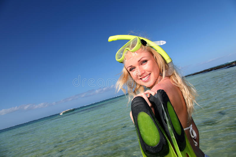 Download Cheerful Woman With Tuba And Flippers Stock Photo - Image: 22085498