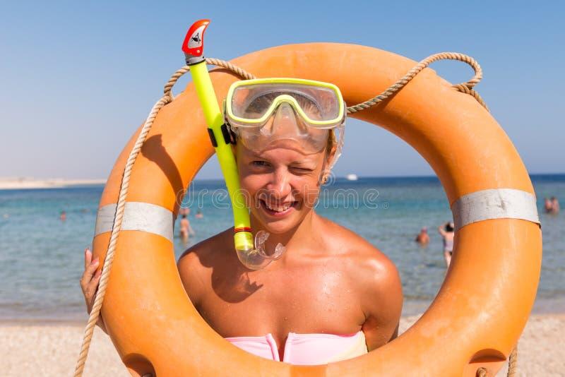 Cheerful woman wearing snorkeling mask royalty free stock photo