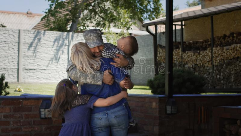 Military man returning home to family stock photos