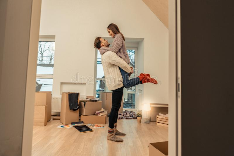 Young people finally moving into new house royalty free stock images