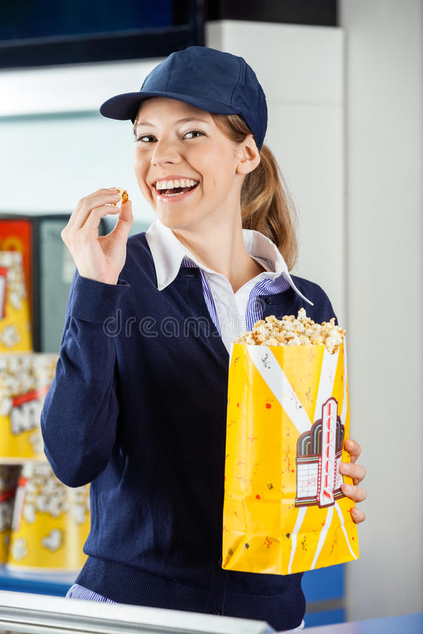 Cheerful Worker Eating Popcorn At Cinema Stock Photo - Image of ...