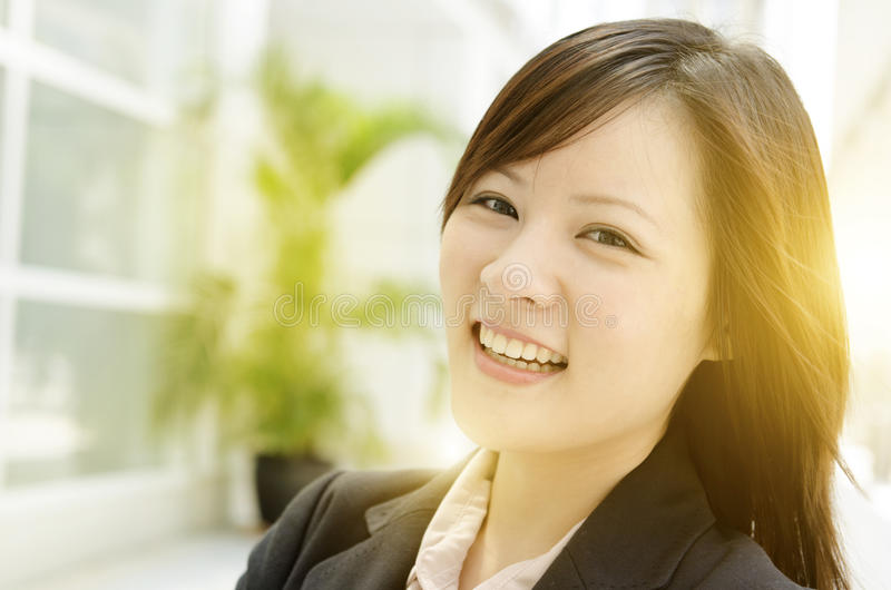 Cheerful young Asian business woman stock photos