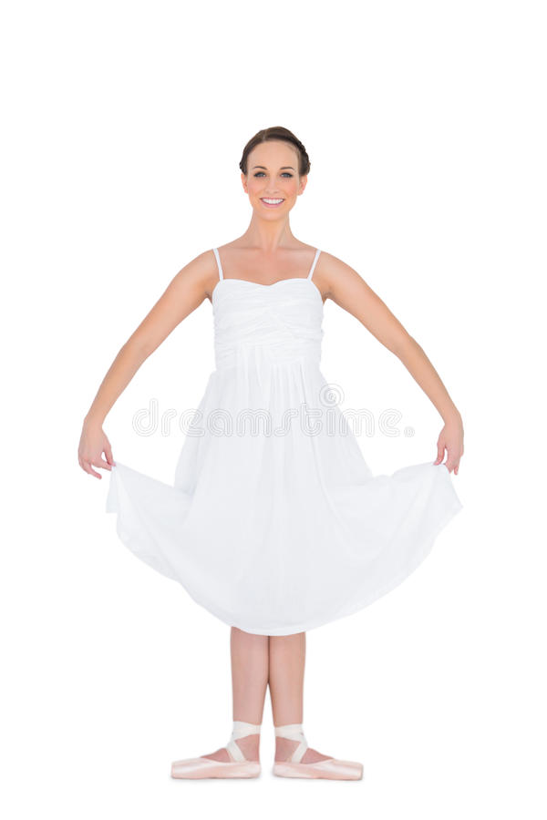 Cheerful young ballet dancer standing in a pose royalty free stock images