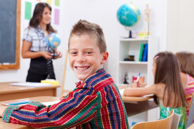 Cheerful young boy in school