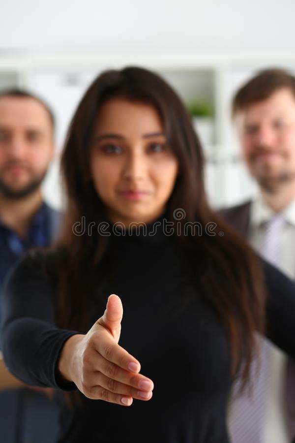 Portrait of cheerful young businessmen in office woman lend hand stock images