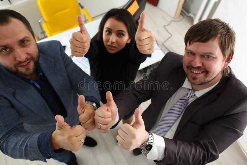 Cheerful young businessmen have success results show big fingers royalty free stock photography